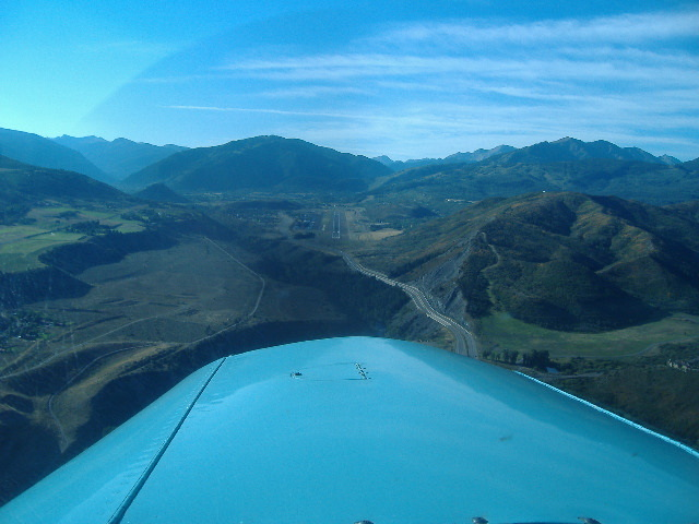 Tom Deml from Little Falls, MN (in his beautiful Commanche) & Lyn Dague on final to Rwy 15 @ Aspen, CO